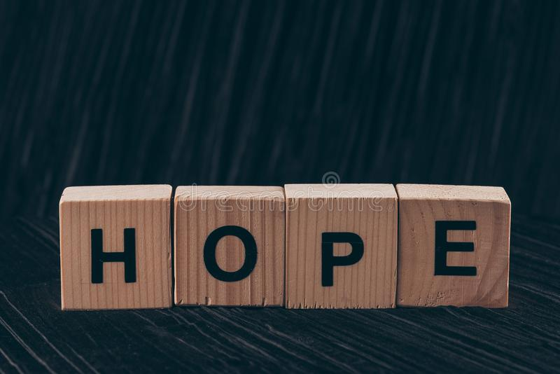 wooden cubes with word Hope stock illustration