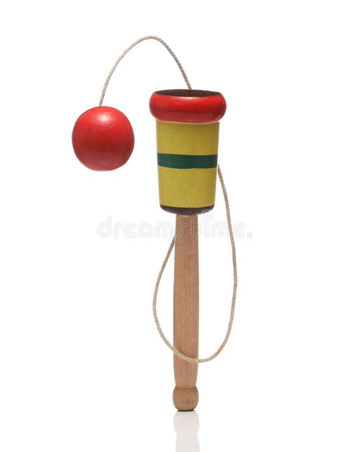 Wooden Cup-and-ball ball in cup toy. Wooden Cup-and-ball ball in cup toy close up on white background stock photos