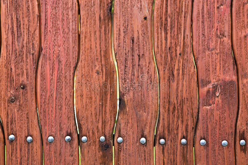 Wooden curved fence of brown color. stock photos