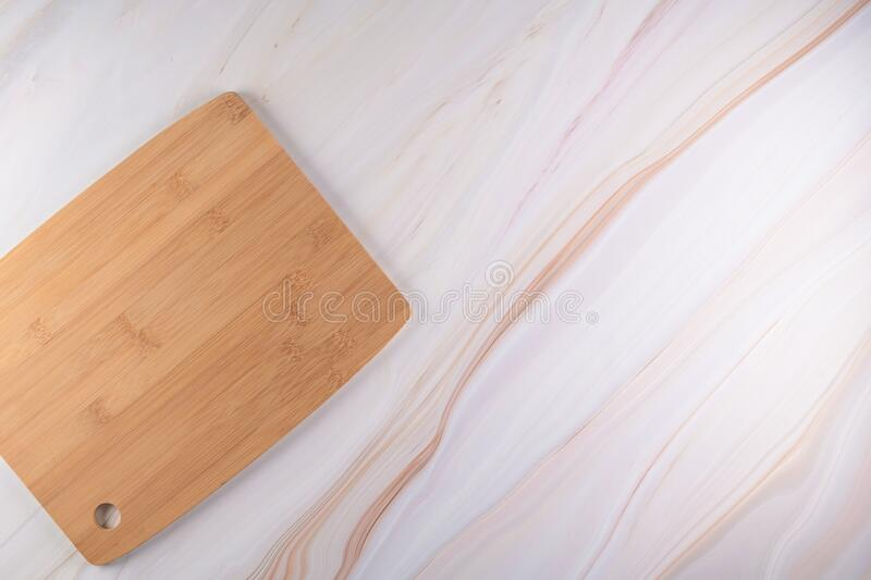 Wooden cutting board on a gray marble background stock images