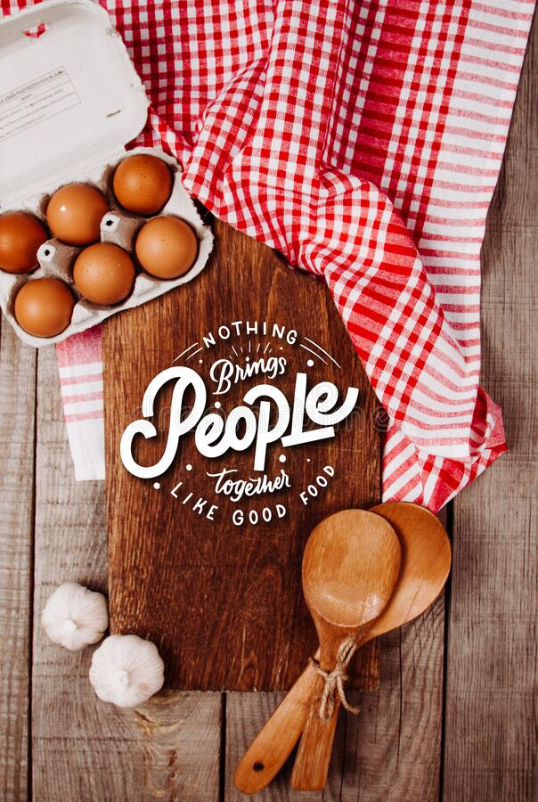Free Wooden Cutting Board On A Wooden Background With Garlic, Ladles, Eggs And A Blank Notebook Royalty Free Stock Images - 178608929
