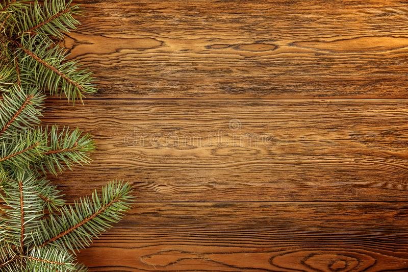 Wooden dark background for Your Christmas titles. Branches of blue spruce. royalty free stock photos