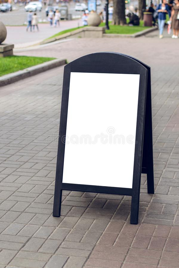Wooden dark restaurant signboard on street with place for your text on it advertising ad advert advertisement object poster placar royalty free stock photos