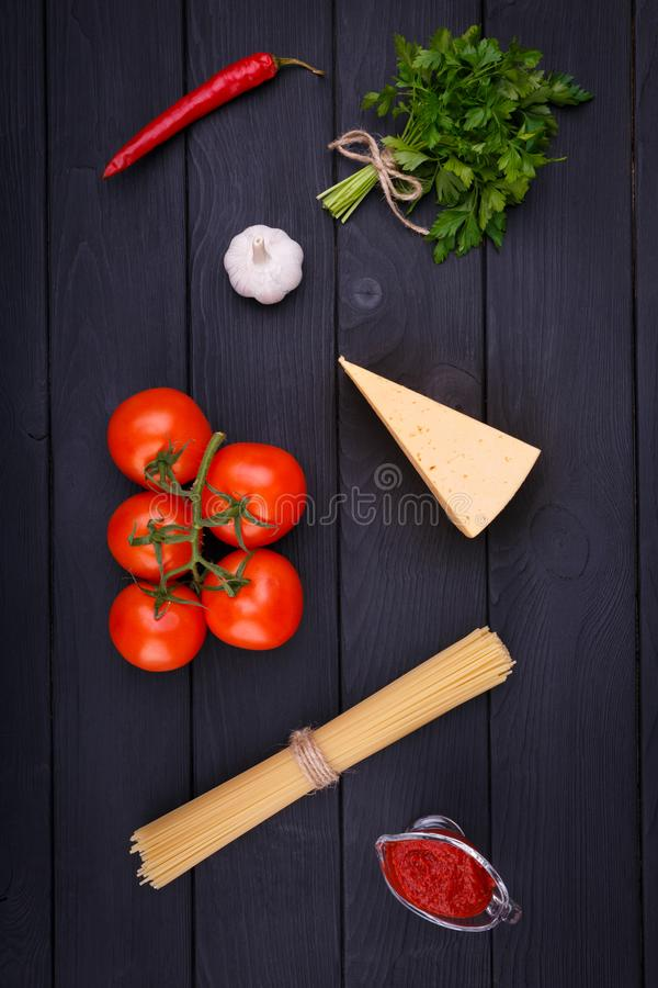 On a table set of products for cooking pasta with cheese and tomatoes. View from above. Indoors. stock photos