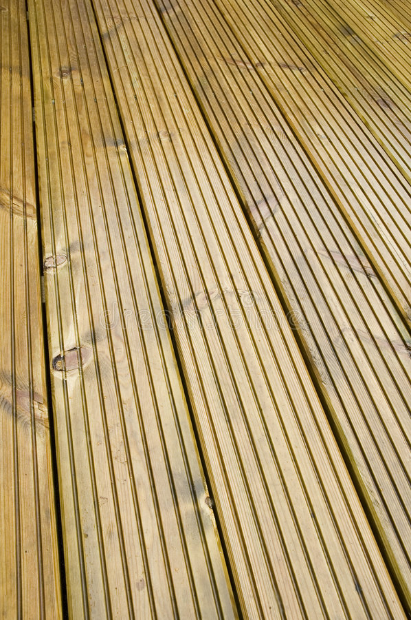 Wooden Deck. Ing with wet sheen stock photography
