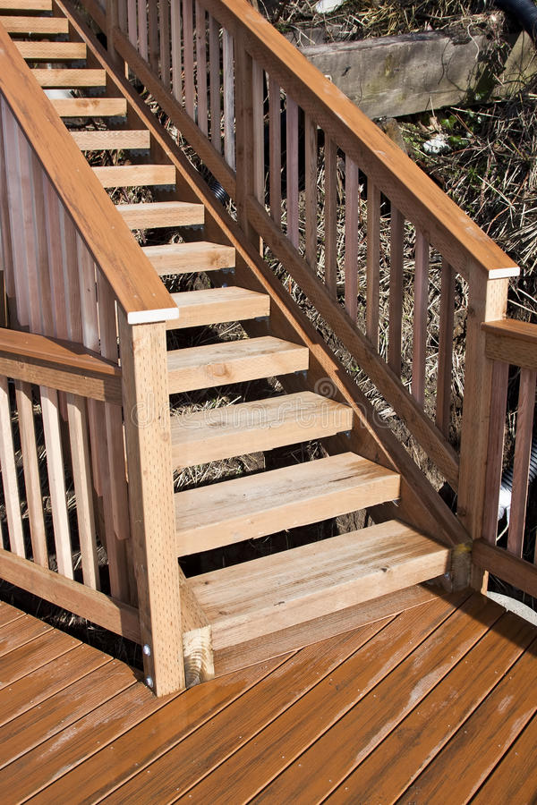 Wooden deck. New wooden deck and stairs on the beach royalty free stock image