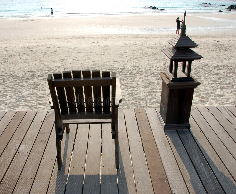 Download Wooden Deck Chair Facing Sea Royalty Free Stock Photography - Image: 816827