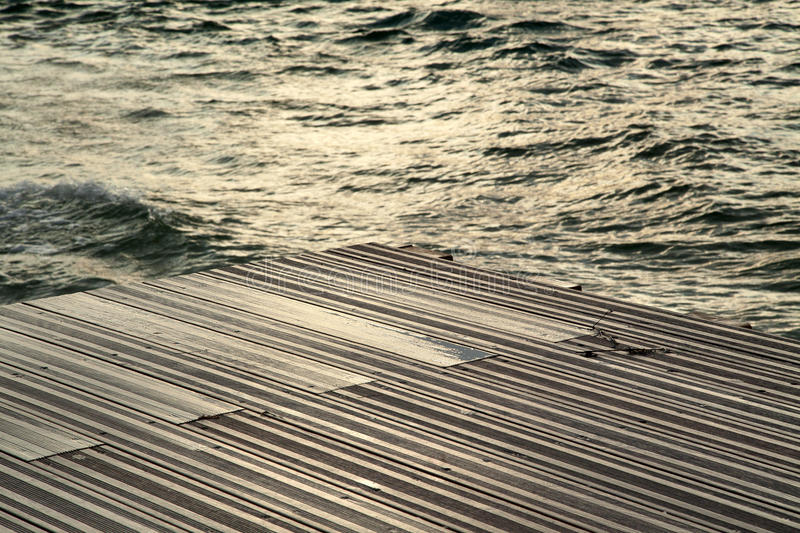 Wet Wooden Deck & Sea stock image