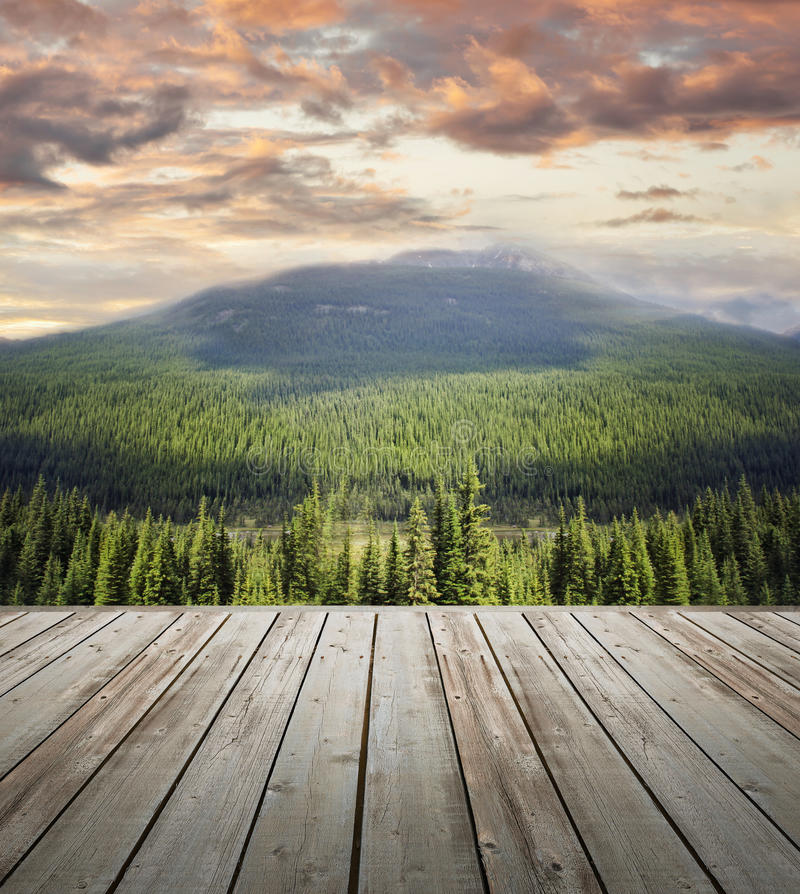 Wooden deck overlooking scenic view of mountains royalty free stock photos