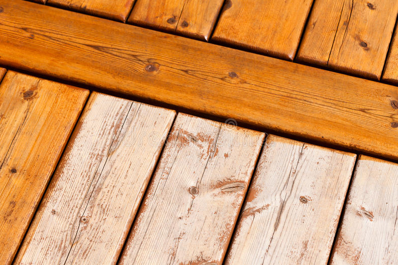 Wooden deck pattern partially stained transparent royalty free stock images