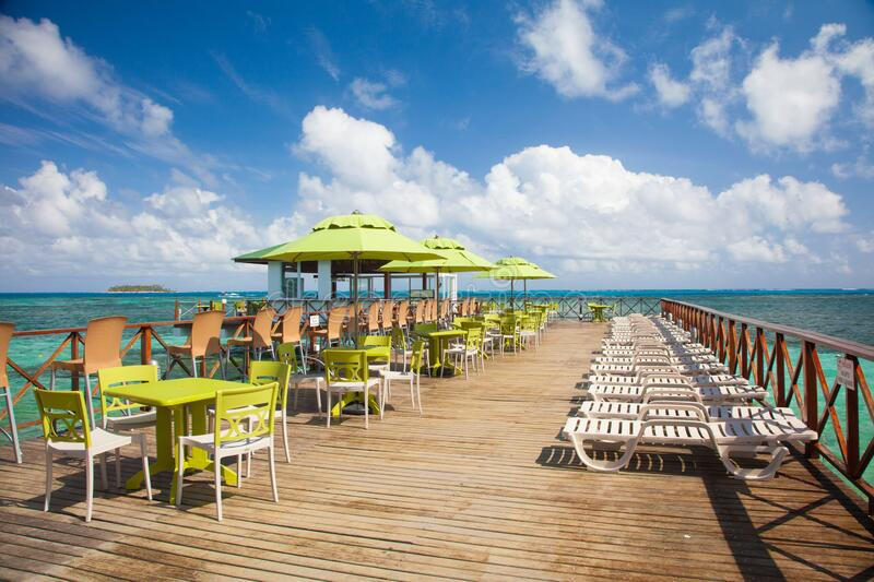 Wooden deck in San Andres Island beach in the caribbean. San Andres Island beach in the caribbean of Colombia. Perfect day and clear water royalty free stock photo