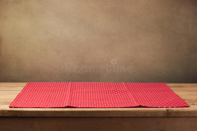 Wooden deck table with polka dots tablecloth over grunge background. Wooden deck table with polka dots tablecloth stock images