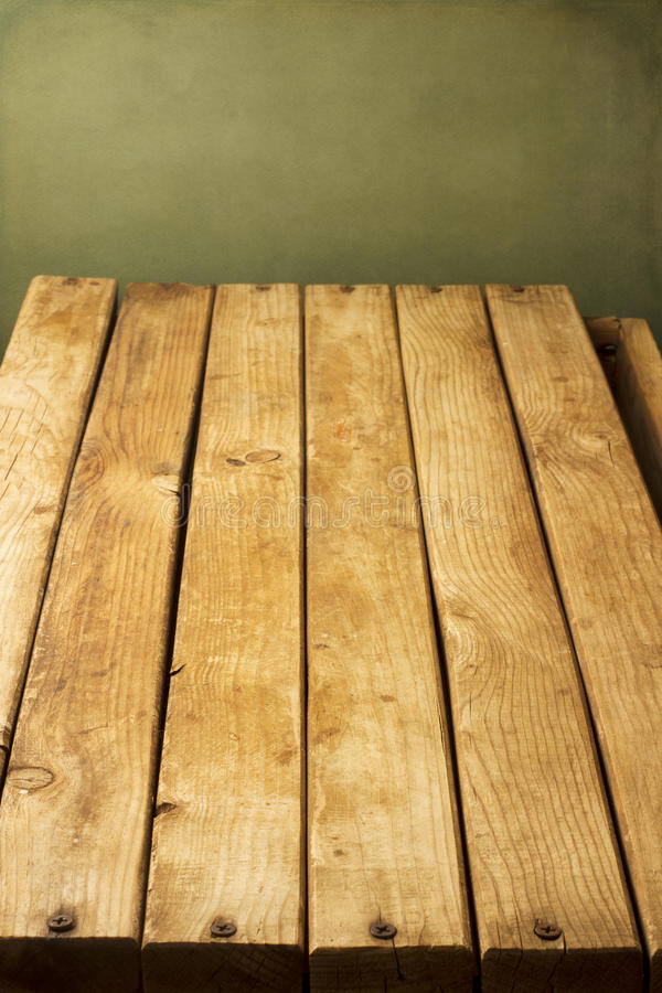 Wooden deck tabletop. Against grunge wall stock photos