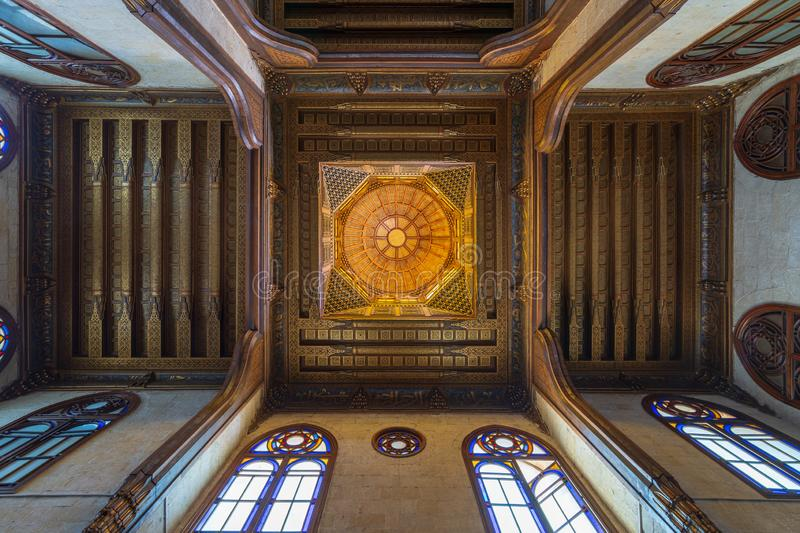 Wooden decorated dome mediating ornate ceiling with floral pattern decorations at al Ghuri Mausoleum, Cairo, Egypt stock photography