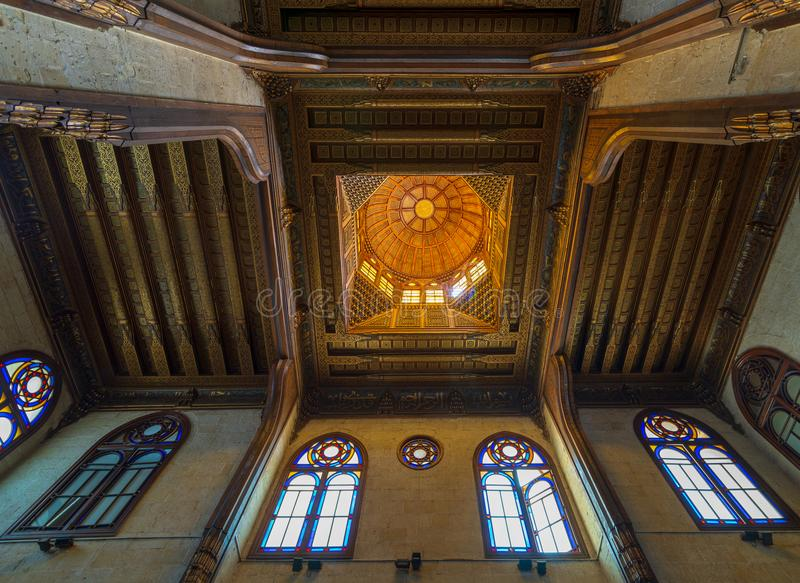Wooden decorated dome mediating ornate ceiling with floral pattern decorations at al Ghuri Mausoleum, Cairo, Egypt stock image