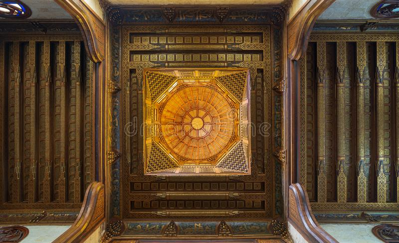 Wooden decorated dome mediating ornate ceiling with floral pattern decorations at Sultan al Ghuri Mausoleum, Cairo, Egypt stock images