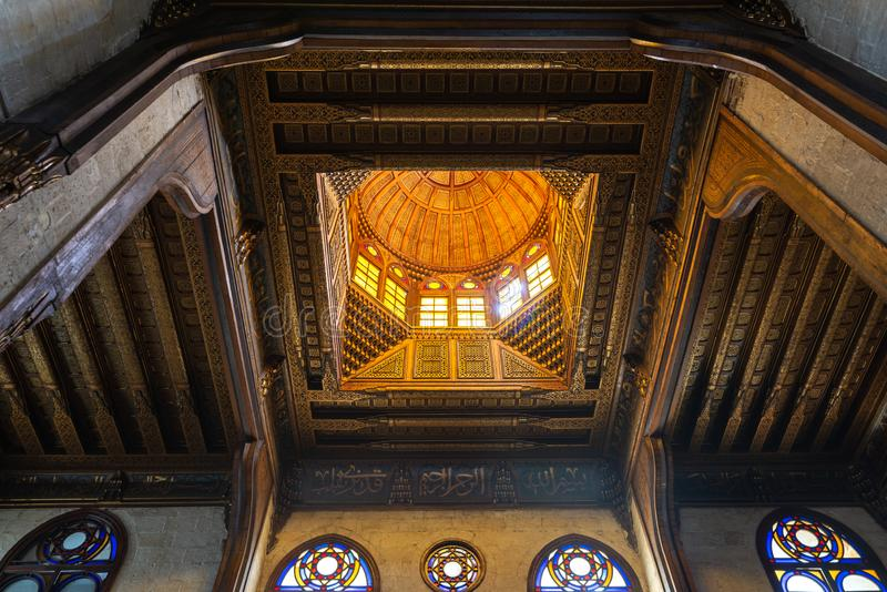 Wooden decorated dome mediating ornate ceiling with floral pattern decorations at Sultan al Ghuri Mausoleum, Cairo, Egypt royalty free stock image