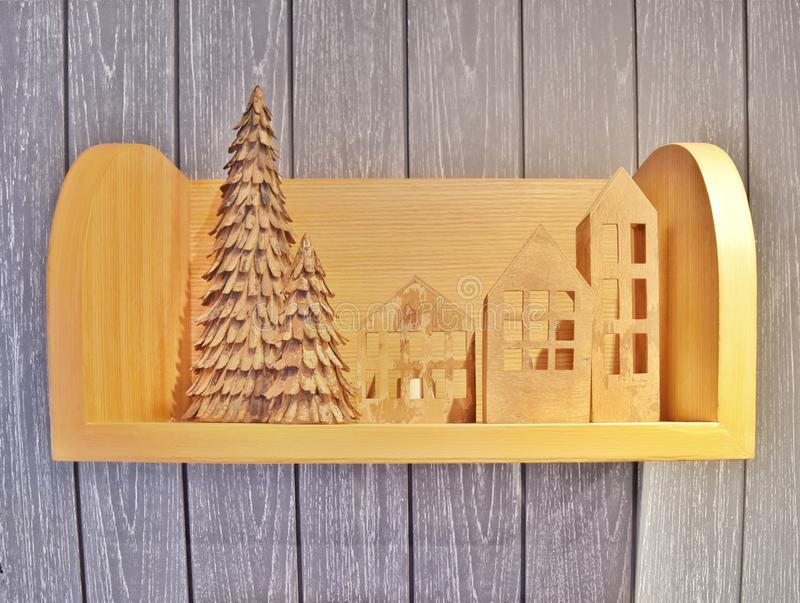 Wooden decoration in Christmas holiday theme on wooden shelf. On wooden wall royalty free stock photography