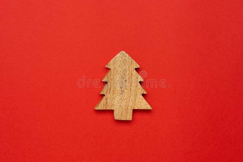 Wooden decoration star for Christmas tree on red color background. Wooden decoration star for Chrismas tree on red color background royalty free stock photos