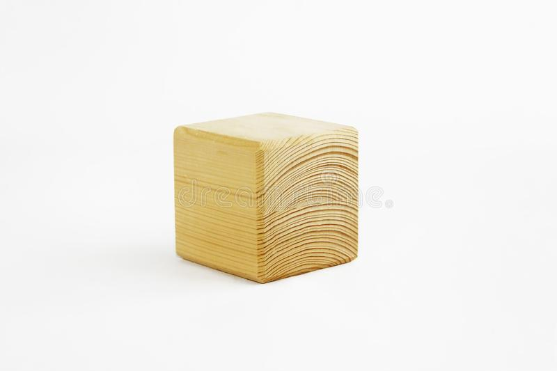 Wooden decorative cube with patterns of divorces on white background. Wooden decorative cube with patterns of divorces on a white background royalty free stock photo