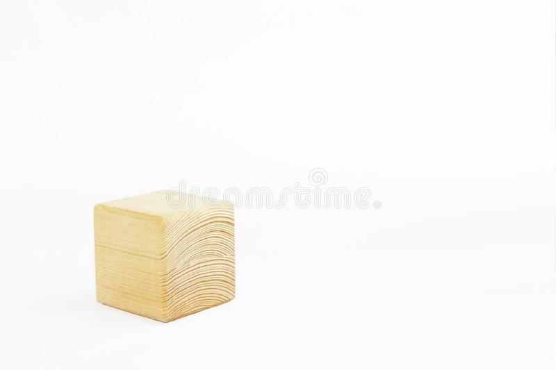 Wooden decorative cube with patterns of divorces on white background. Wooden decorative cube with patterns of divorces on a white background stock photography