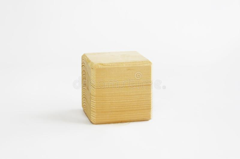 Wooden decorative cube with patterns of divorces on white background. Wooden decorative cube with patterns of divorces on a white background stock image