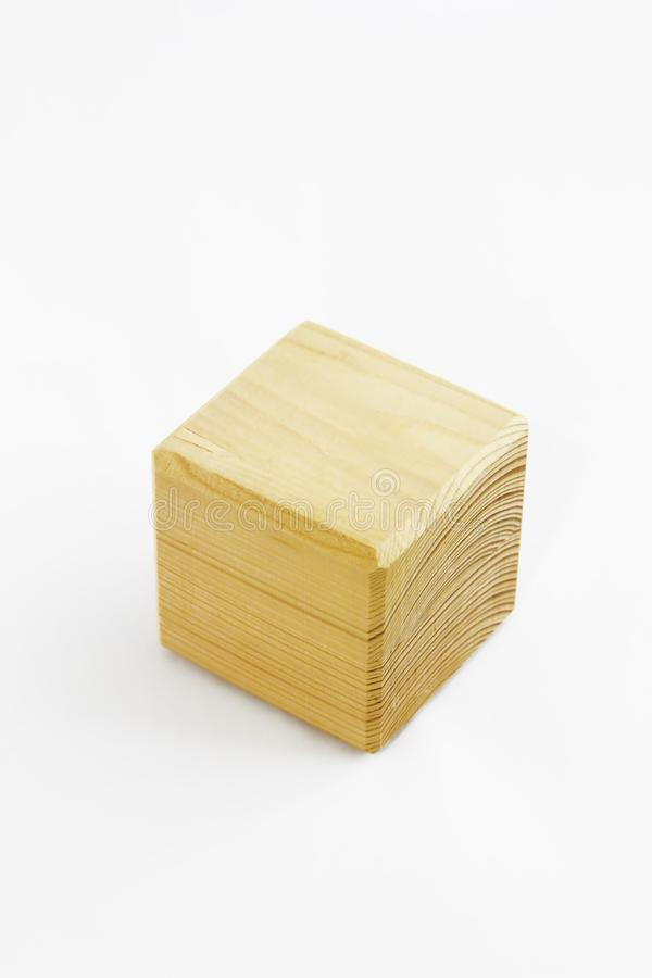 Wooden decorative cube with patterns of divorces on white background. Wooden decorative cube with patterns of divorces on a white background royalty free stock photos