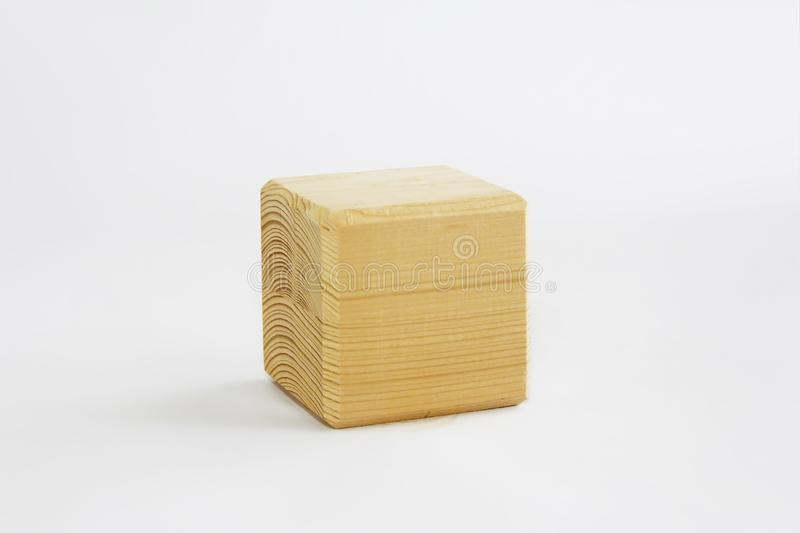 Wooden decorative cube with patterns of divorces on white background. Wooden decorative cube with patterns of divorces on a white background stock photo