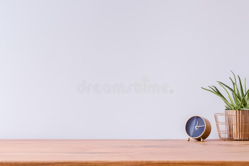 Wooden desk and empty wall royalty free stock images