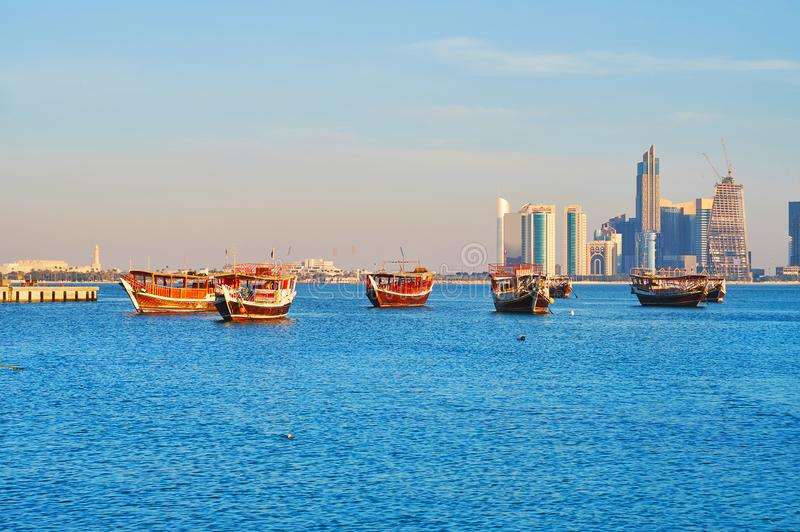 Persian Gulf in Doha, Qatar. Wooden dhow boats are popular among the tourists, visiting Doha, these vessels are perfect for the trips along the coast and fishing royalty free stock photo
