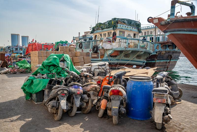 Wooden dhow cargo boats loaded with merchandise on Dubai Creek, UAE royalty free stock photos