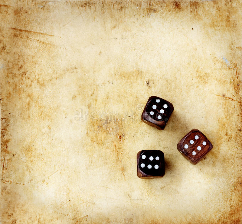 Wooden dice on a vintage background royalty free illustration