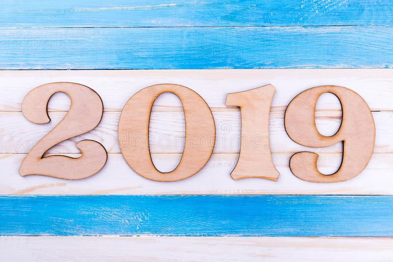 Wooden digit 2019 on wooden background, space for text royalty free stock photography