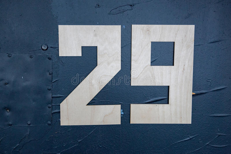 Wooden digits on the door. Large wooden digits on the blue front door stock photo