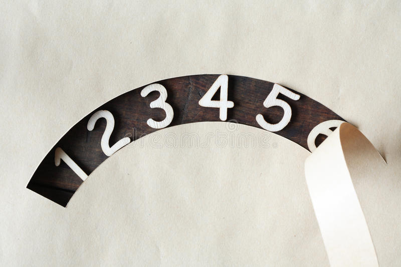 Wooden Digits. Set of wooden digits in hole of cutting paper royalty free stock photos