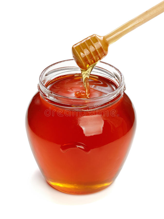 Wooden dipper with jar of honey. royalty free stock photos