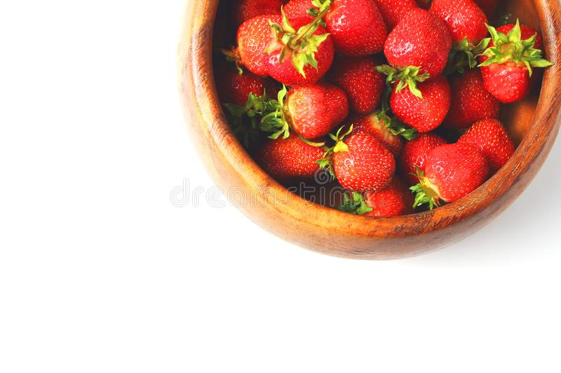 Wooden dish with strawberries. white background, flat lay, copy space. Wooden dish with strawberries. white background, flat lay stock photography