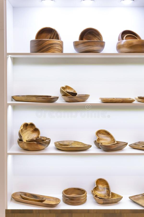 Wooden dishes. Kitchen utensils and accessories made of bamboo. Eco-friendly products. Various salad bowls, dishes, plates, food. Trays and spoons on a stock images