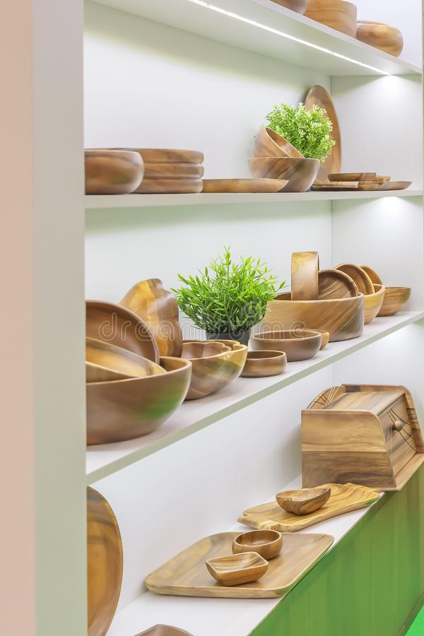 Wooden dishes. Kitchen utensils and accessories made of bamboo. Eco-friendly products. Various salad bowls, dishes, plates, food. Trays and spoons on a stock image