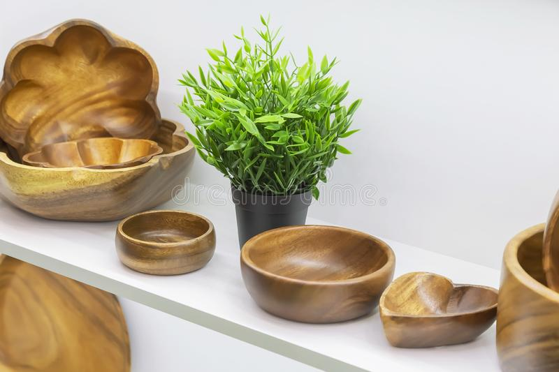 Wooden dishes. Kitchen utensils and accessories made of bamboo. Eco-friendly products. Various salad bowls, dishes, plates for. Food on a showcase shelf in a royalty free stock photos