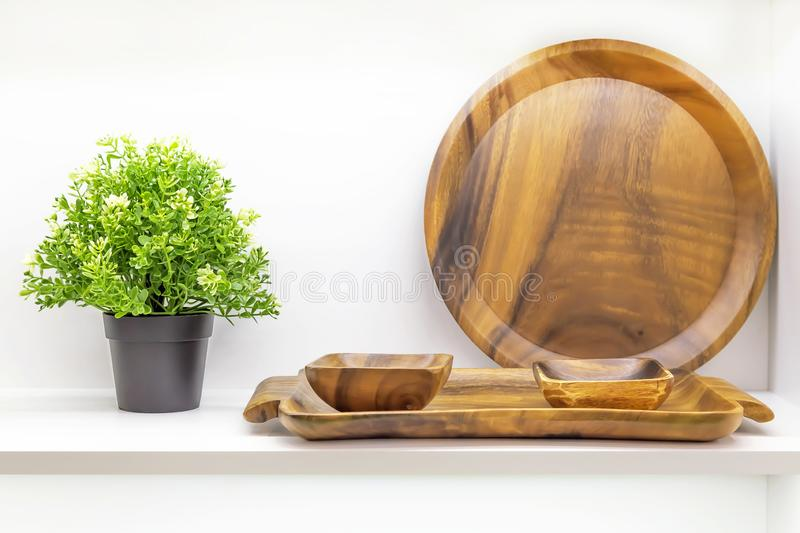 Wooden dishes. Kitchen utensils and accessories made of bamboo, interior details. Eco-friendly products. Various salad bowls, stock images