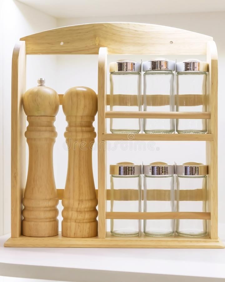 Wooden dishes. Kitchen utensils and accessories made of glass and wood, interior details. Empty spice jars on a shelf. Container, bottle, set, various, spicy royalty free stock images