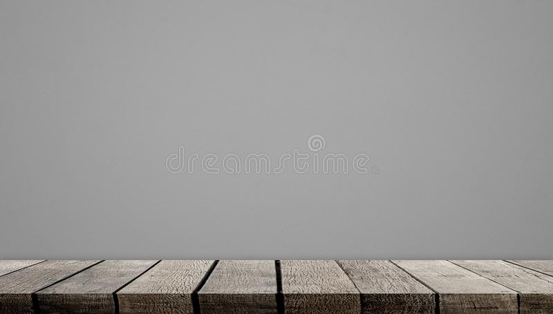 Wooden display shelf on gray cement wall royalty free stock photos