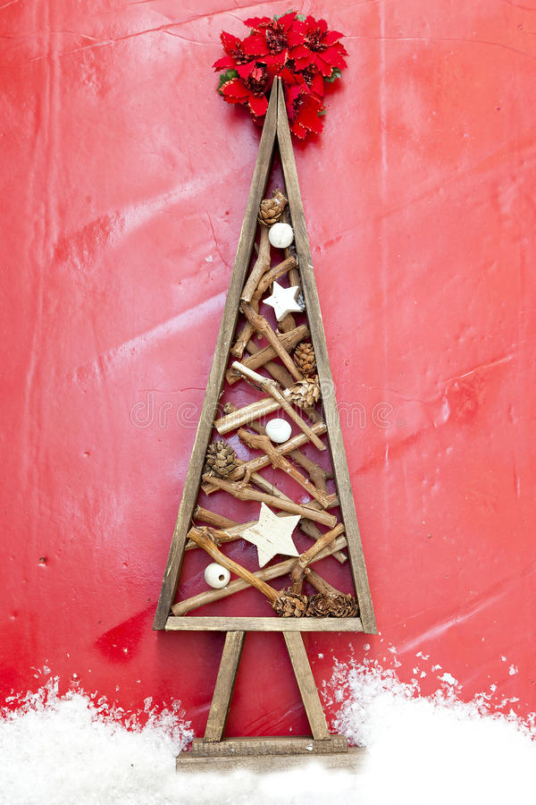 Wooden diy christmas tree over a red background royalty free stock photos