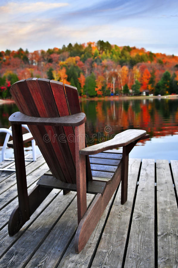 Download Wooden dock on autumn lake stock photo. Image of chairs - 9958886