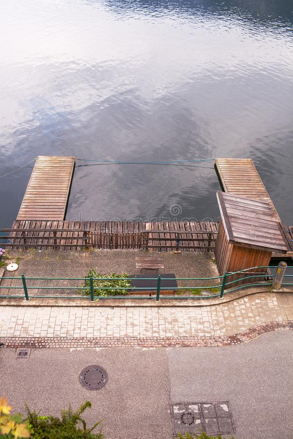 Wooden dock for boats in the city Hallstatt, Austria.  royalty free stock image
