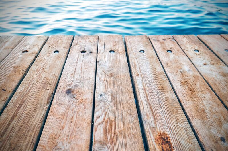 Wooden dock on lake royalty free stock photo