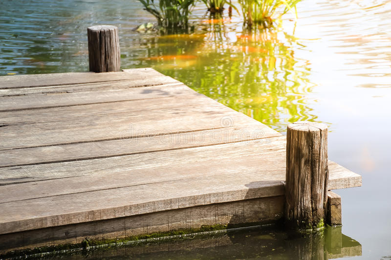 Wooden dock on the lake royalty free stock photography