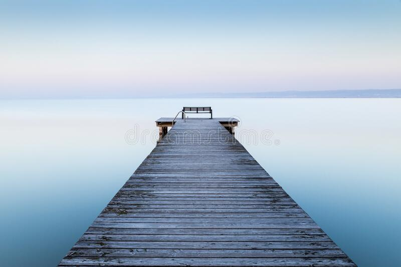 Wooden dock near the sea with the fog in the background. A wooden dock near the sea with the fog in the background stock photos