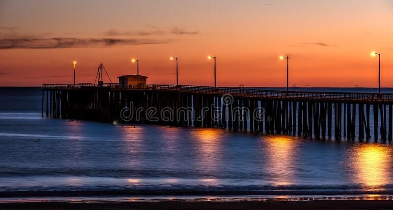 Wooden Dock on Sea Shore With Light Post during Sunset stock photos